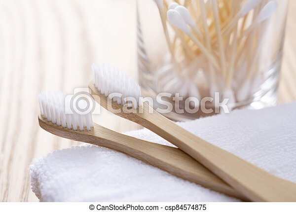 Bamboo toothbrush and bamboo cotton swabs - csp84574875