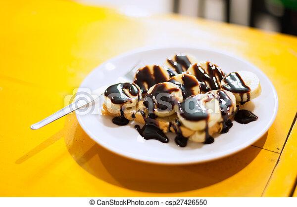 Banana chocolate in soft light - csp27426550