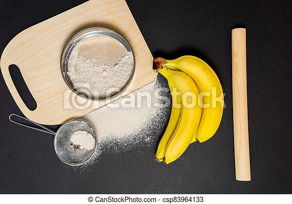 banana flour type of flour for baking . gluten free plant flour. gluten intolerance concept. - csp83964133