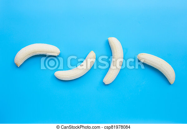 Banana on blue background. Top view - csp81978084