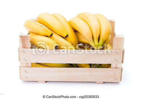 Bananas in wooden crate - csp25383033