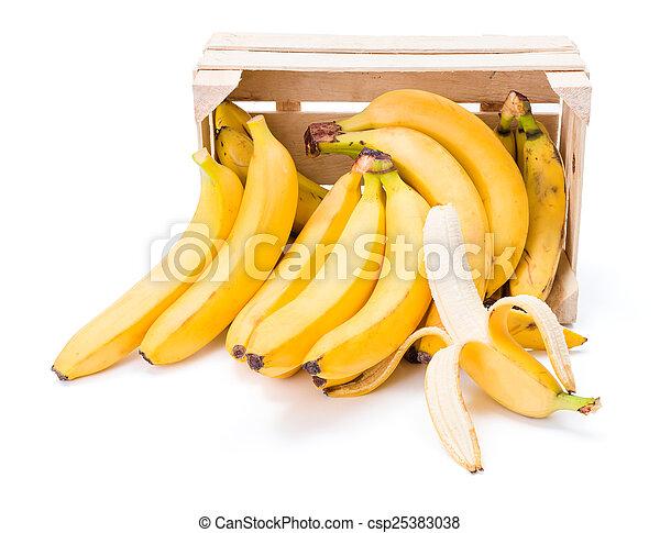 Bananas in wooden crate - csp25383038