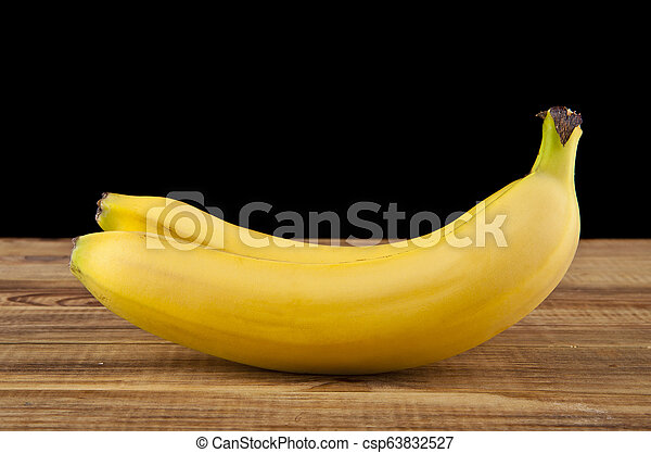 bananas on a black background - csp63832527