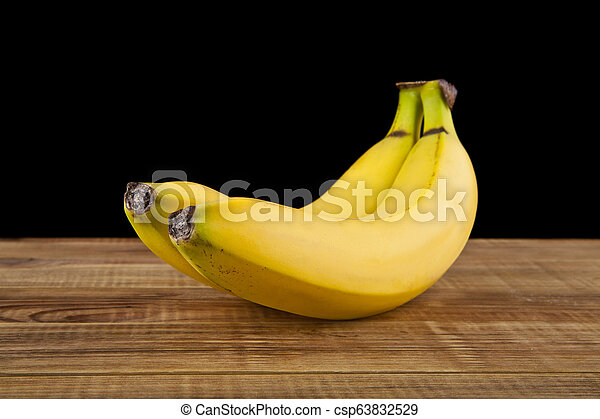 bananas on a black background - csp63832529