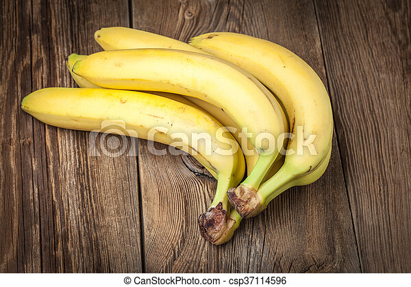 Bananas on a wooden background. - csp37114596