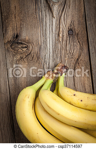 Bananas on a wooden background. - csp37114597