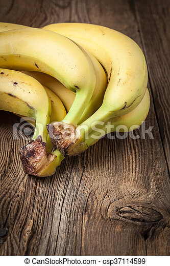 Bananas on a wooden background. - csp37114599