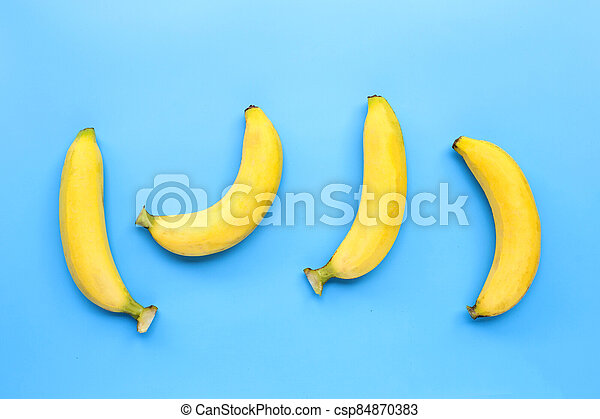 Bananas on blue background. Top view - csp84870383
