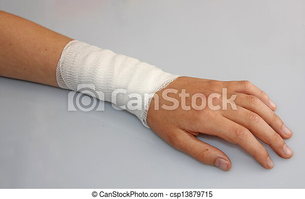 bandaged arm of a child because of a skin lesion - csp13879715