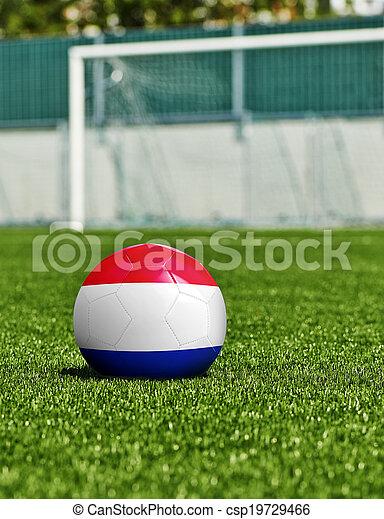 Bola de fútbol con bandera de Holanda en el césped del estadio - csp19729466