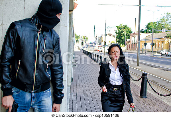Bandit in mask with gun waiting for victim - csp10591406