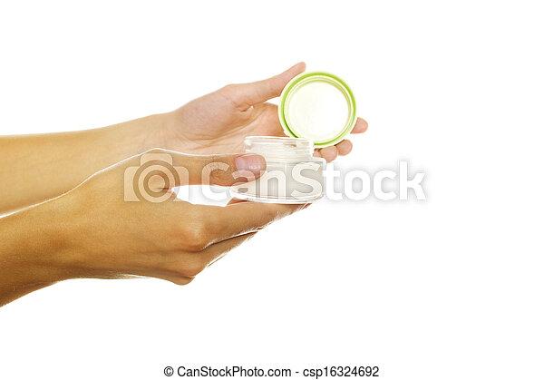 Bank of the cream into women hands - csp16324692