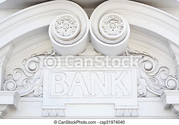 Bank sign in stone on facade - csp31974040
