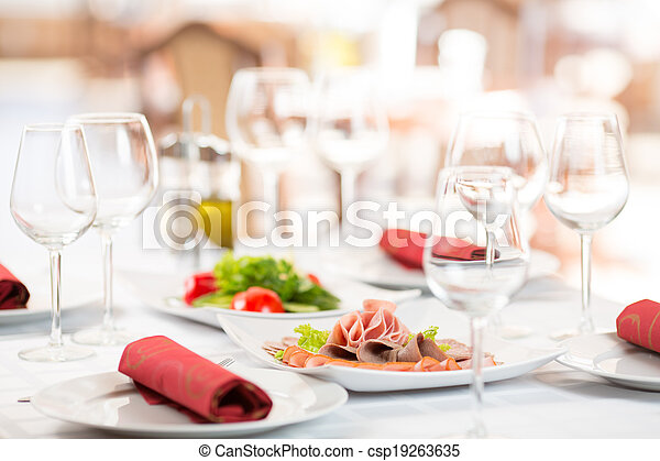 Banquet setting table in restaurant interior - csp19263635
