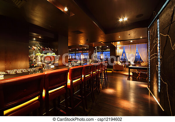 bar counter with chairs in empty comfortable restaurant at night - csp12194602