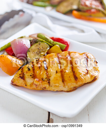 barbecued chicken with fresh vegetable sides - csp10991349