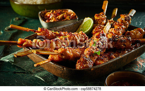 Barbecued satay skewers with diced seasoned meat - csp58874278