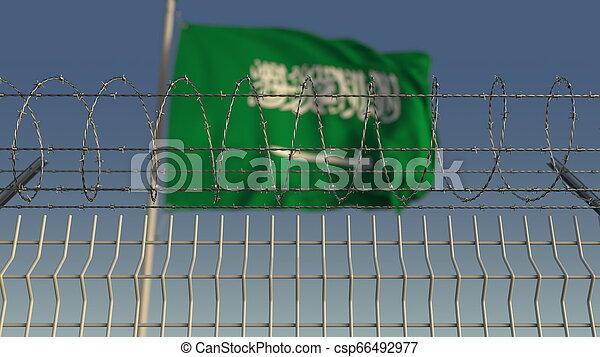 Barbed wire against waving flag of Saudi arabia. 3D rendering - csp66492977