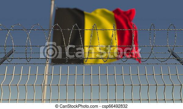 Barbed wire against waving flag of Belgium. 3D rendering - csp66492832