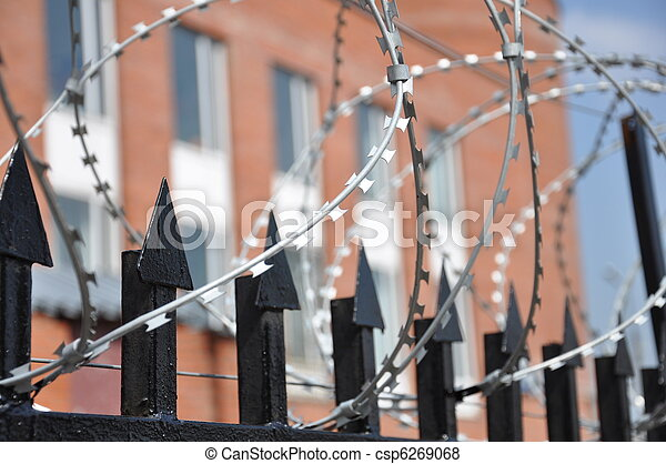Barbed wire fence at the prison - csp6269068