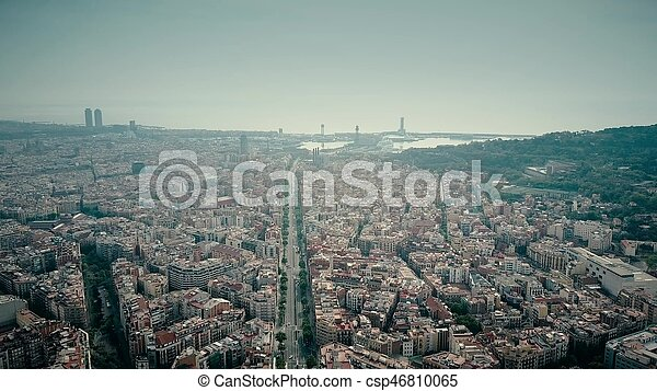 Barcelona city aerial shot, Spain. Distant sea port - csp46810065