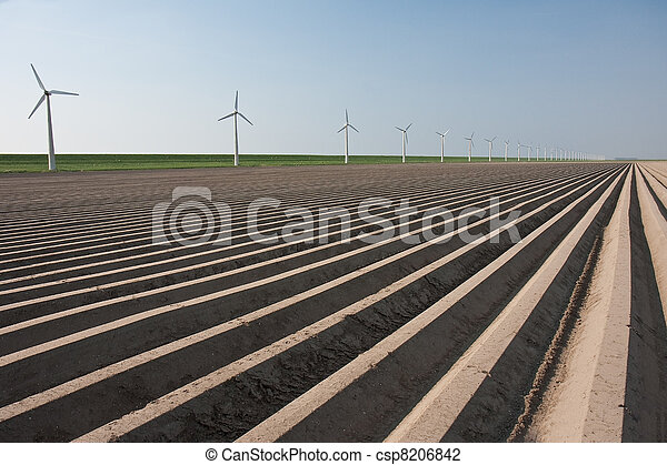 Bare farmland in the netherlands, waiting for spring - csp8206842
