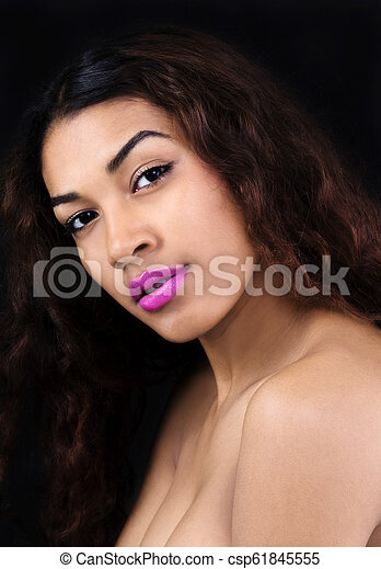 Bare Shoulder Portrait Attractive Hispanic Woman On Dark Background - csp61845555