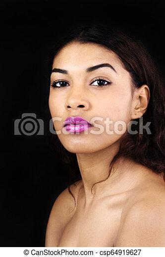 Bare Shoulder Portrait Attractive Hispanic Woman On Dark Background - csp64919627
