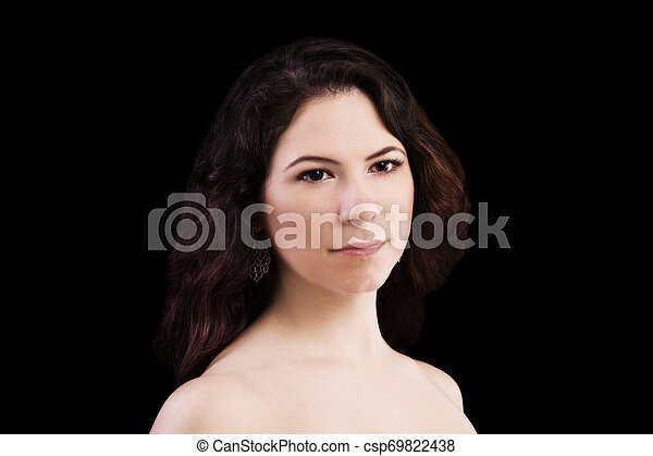Bare Shoulder Portrait Of Young Caucasian Woman Dark Background - csp69822438