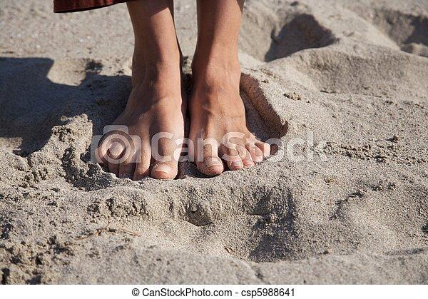 barefoot on sand - csp5988641