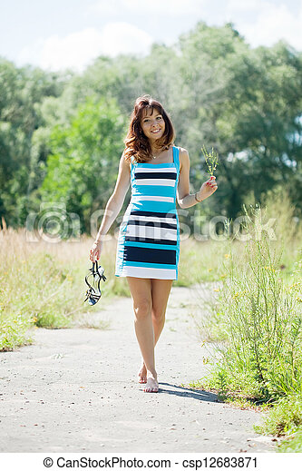 barefoot woman walking in  park - csp12683871