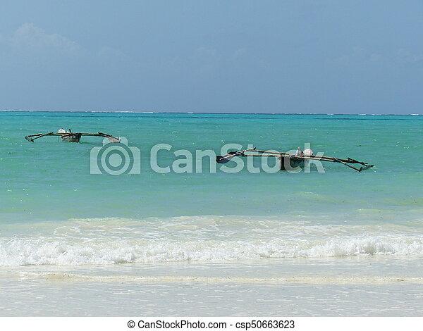 Barges in blue ocean - csp50663623