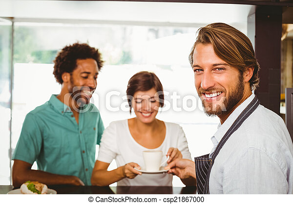 Barista talking with two customers - csp21867000