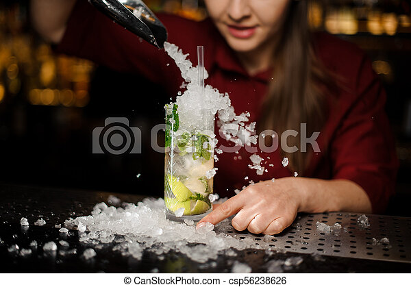 barmaid adds to mojito crushed ice - csp56238626