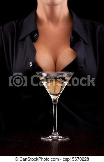 Barmaid mixing drink - csp15670228