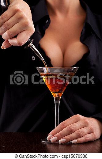Barmaid mixing drink - csp15670336