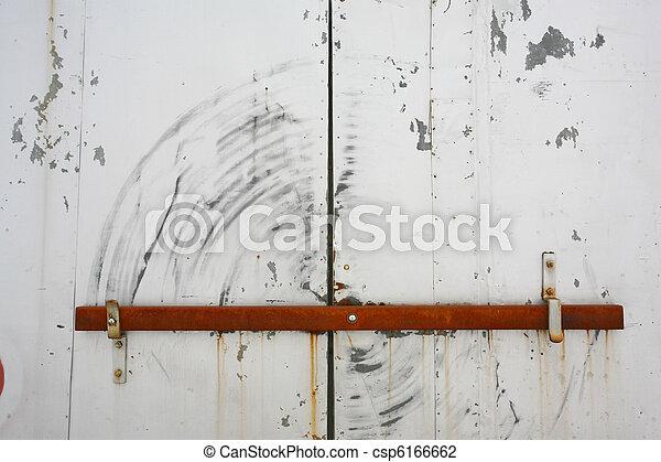 Barred door - csp6166662 & Barred door of old warehouse.