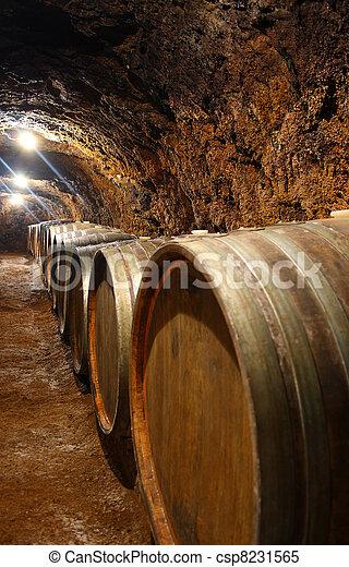 Barrels in a wine cellar  - csp8231565
