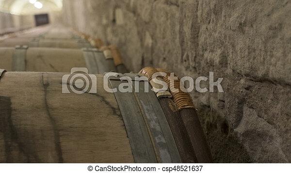 barrels in a wine cellar - csp48521637