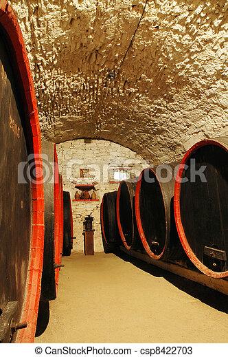 Barrels in a wine-cellar - csp8422703