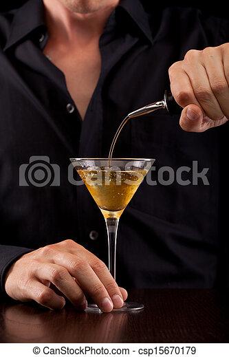 Bartender pours drink - csp15670179
