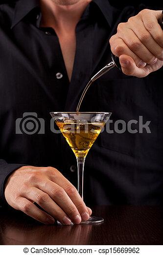 Bartender pours drink - csp15669962