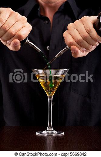 Bartender pours drink - csp15669842