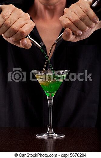 Bartender pours drink - csp15670204
