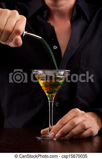 Bartender pours drink - csp15670035