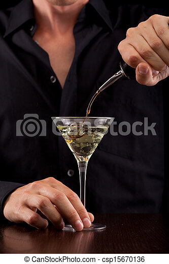 Bartender pours drink - csp15670136