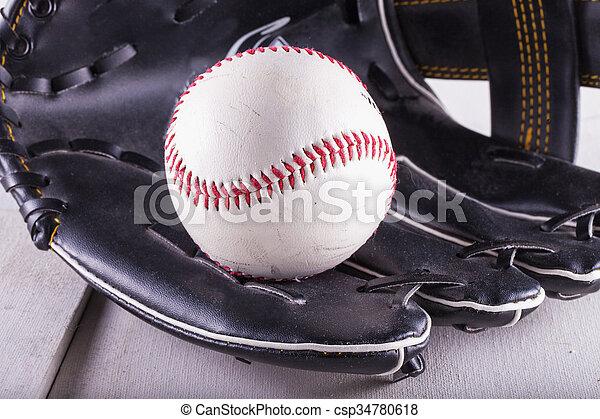 Baseball in glove - csp34780618