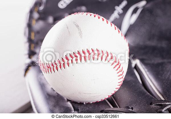 Baseball in glove - csp33512661