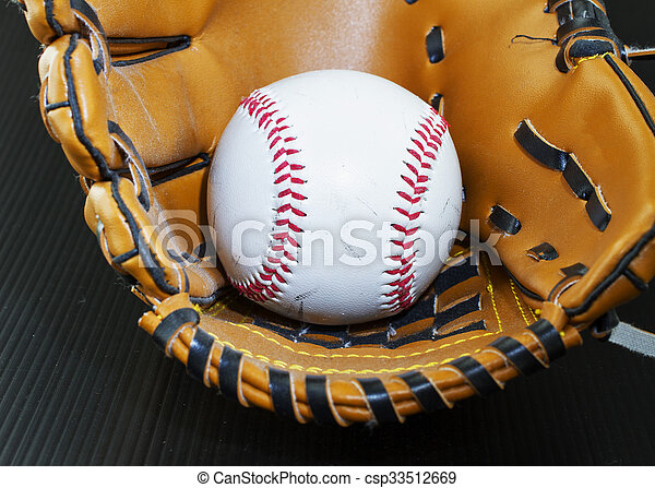 Baseball in glove - csp33512669