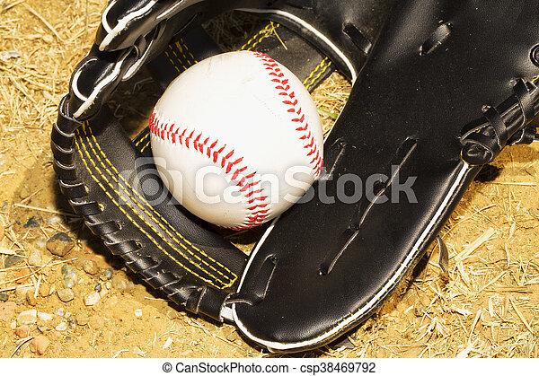 Baseball in glove - csp38469792